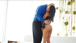 Tanned chick dressed in black gets fucked by an old dude